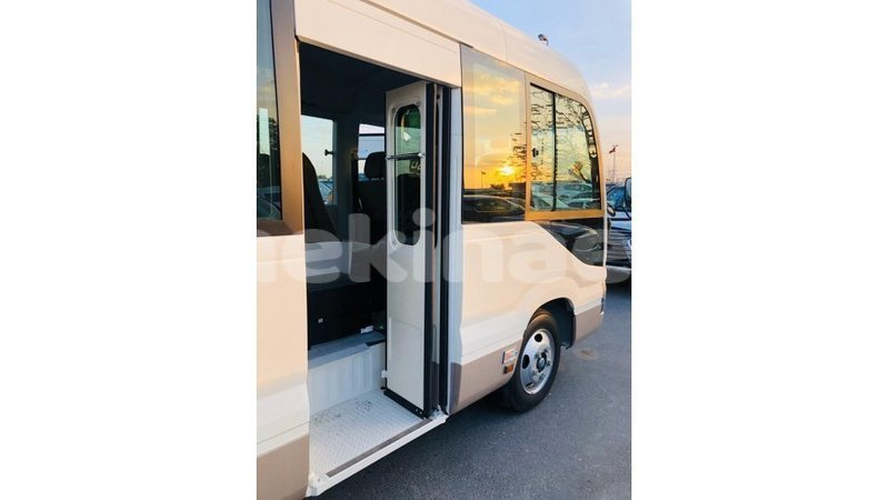 Big with watermark toyota coaster anseba import dubai 3423